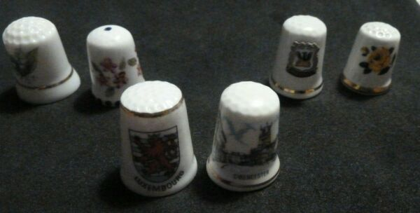 SIX COLLECTABLE CERAMIC CHINA THIMBLES