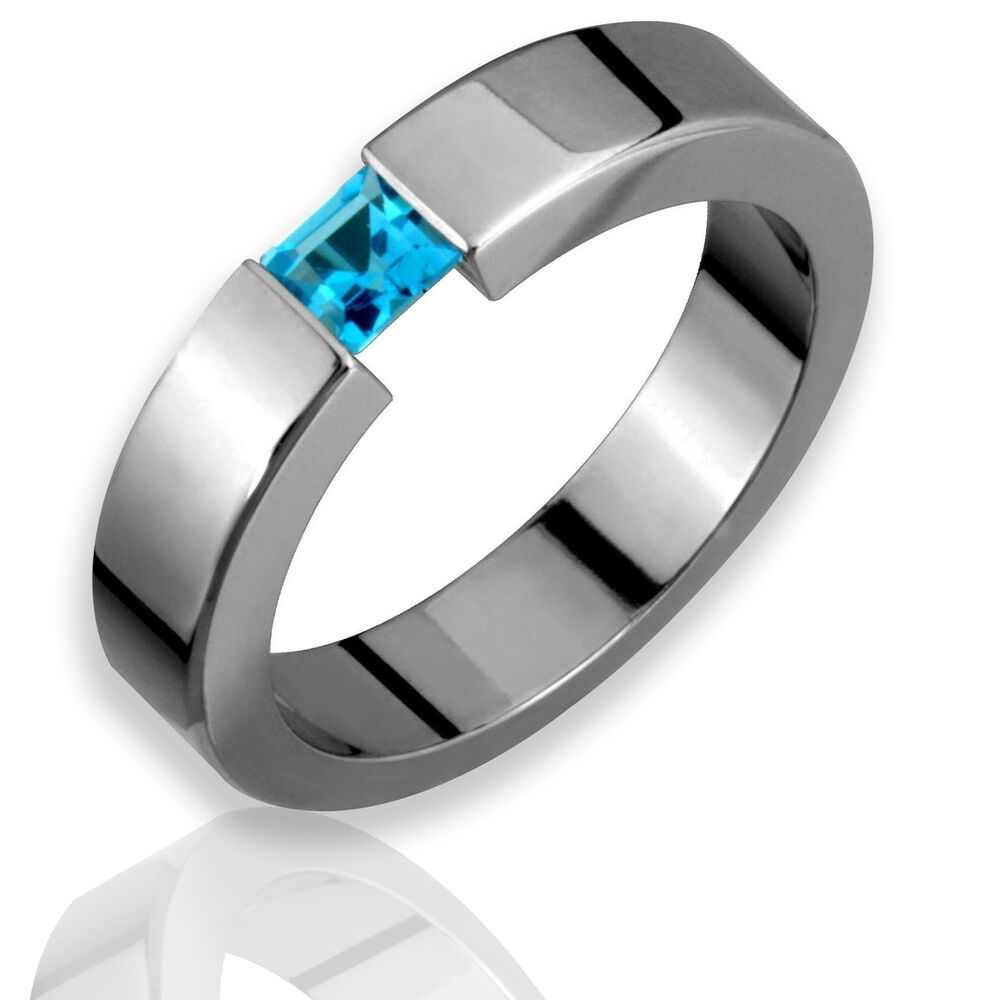 Titanium Ring W Tension Set Blue Topaz Birthstone Polish