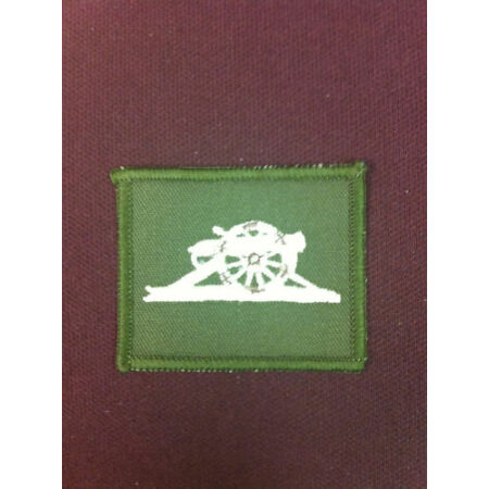 img-Royal Artillery Gunners Badge Ivory on Olive.