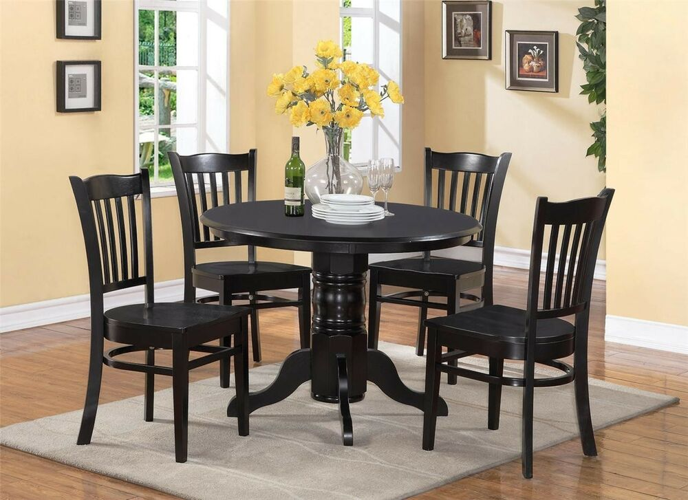 5 pc shelton round dinette kitchen table with 4 wood seat for Dinette furniture