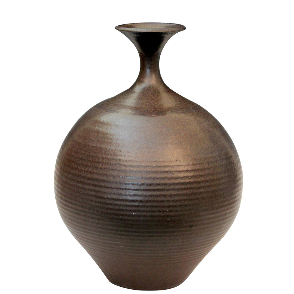 Stoneware vases with texture will lend your home tons of visual interest. Try a vase that's featured with a rich texture that gives it a modern edge. These textures can range from divots or geometric shapes to something with a thick, dripping glaze.