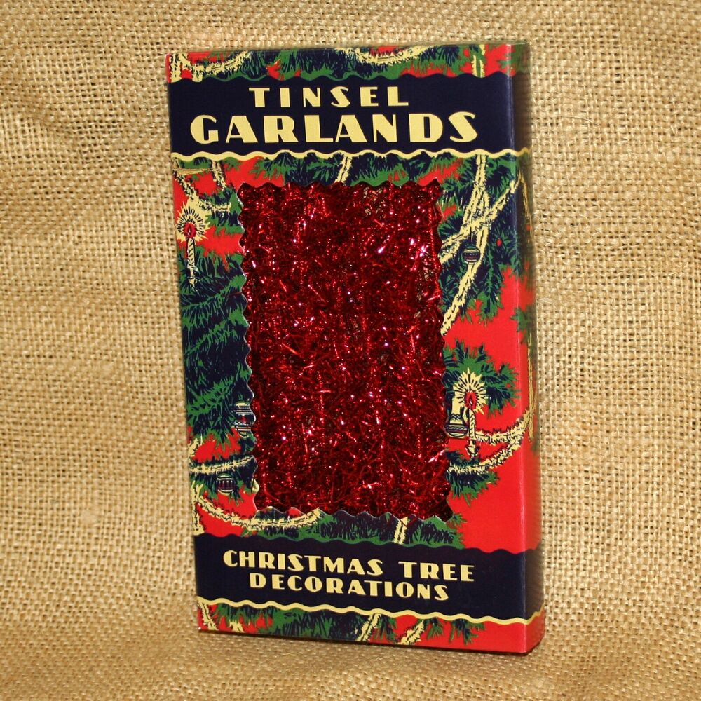 Red tinsel garland in vintage antique box christmas