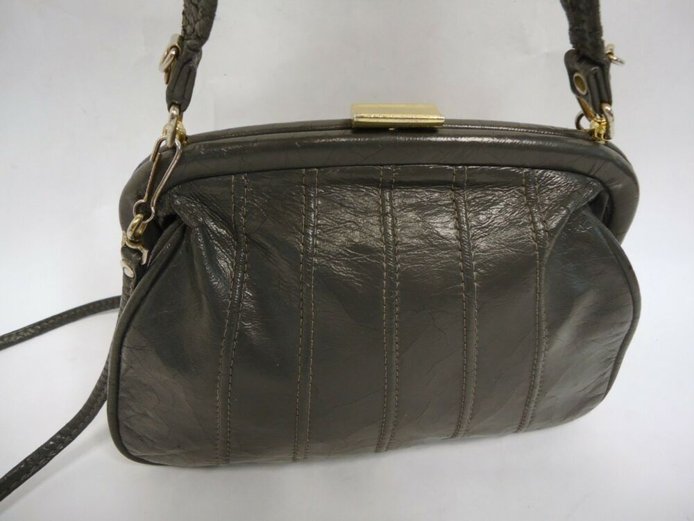 You searched for: gray leather purse! Etsy is the home to thousands of handmade, vintage, and one-of-a-kind products and gifts related to your search. No matter what you're looking for or where you are in the world, our global marketplace of sellers can help you find unique and affordable options. Let's get started!