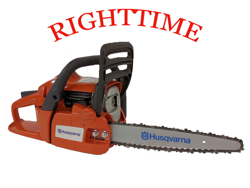 Husqvarna chainsaw fitted with quot carving kit dime