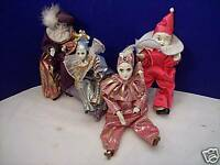 Collection of 4 Porcelain/Cloth Dolls