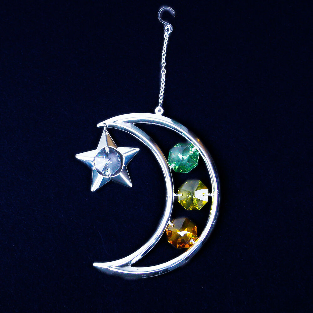 silver moon and stars christmas ornament with multicolored