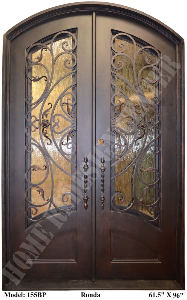 Wrought iron entry doors doors with forged iron eyebrow - Wrought iron exterior door hardware ...