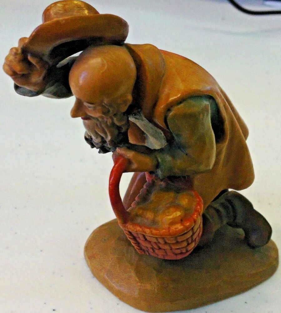 Anri man kneeling with basket hand carved wooden figurine