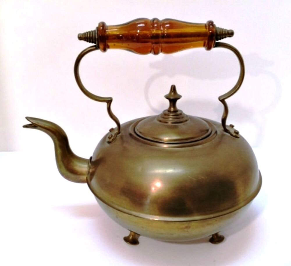 Antique brass footed kettle with lid amber glass handle