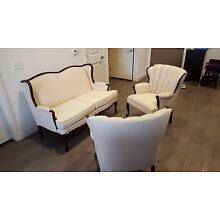 Vintage armchairs and a loveseat