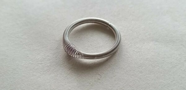 Silver coloured stackable stretch expanding ring with lilac coloured bead