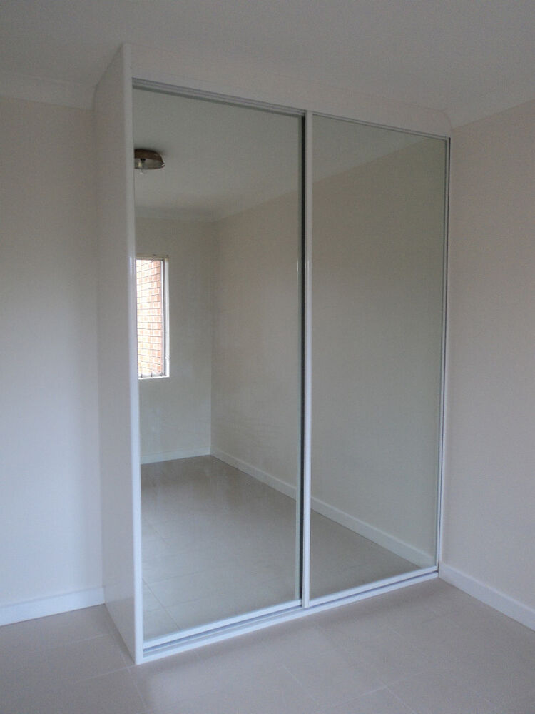 Diy built in wardrobe mirror glass sliding doors made to for Built in sliding doors