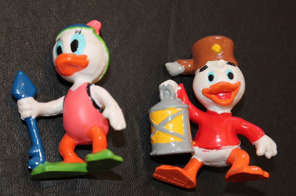 two girls with a duck and sex toys
