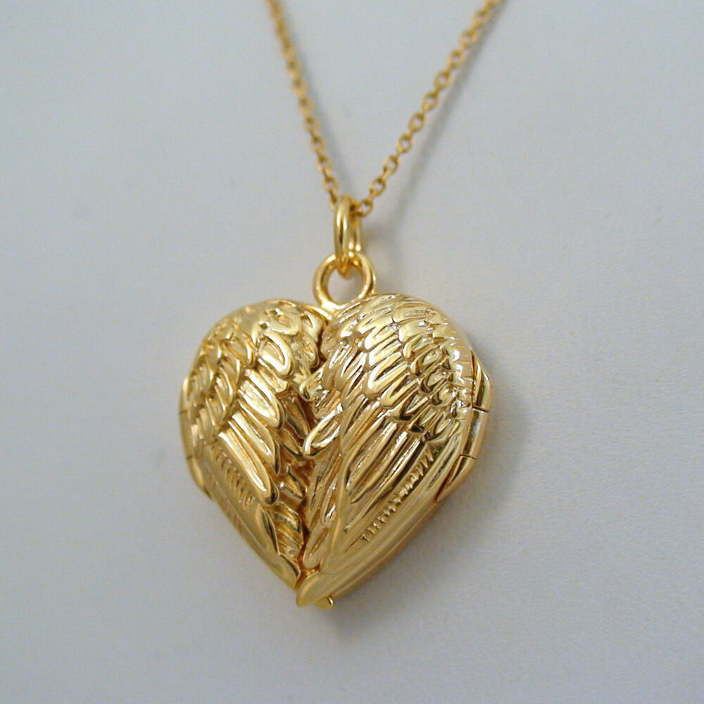 Angel Wings Heart Locket  14k Gold Plated Sterling Silver. Iridescent Bands. Intricate Silver Bands. Wide Yellow Gold Bands. Old Fashioned Bands. Simple Bands. Man's Finger Bands. 4mm Bands. Half Heart Bands