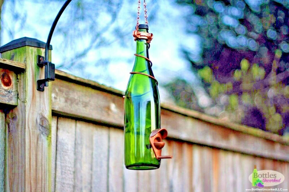 Green and copper glass wine bottle bird feeder gift for for Outdoor decorating with wine bottles
