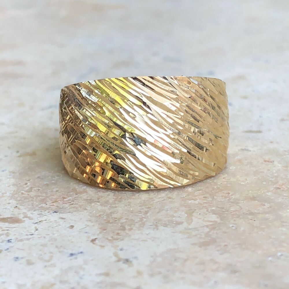 14 kt yellow gold polished cut design domed wide