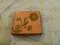 Vintage Painted Metal Compact with Copper Lid Featuring a Raised Floral Pattern