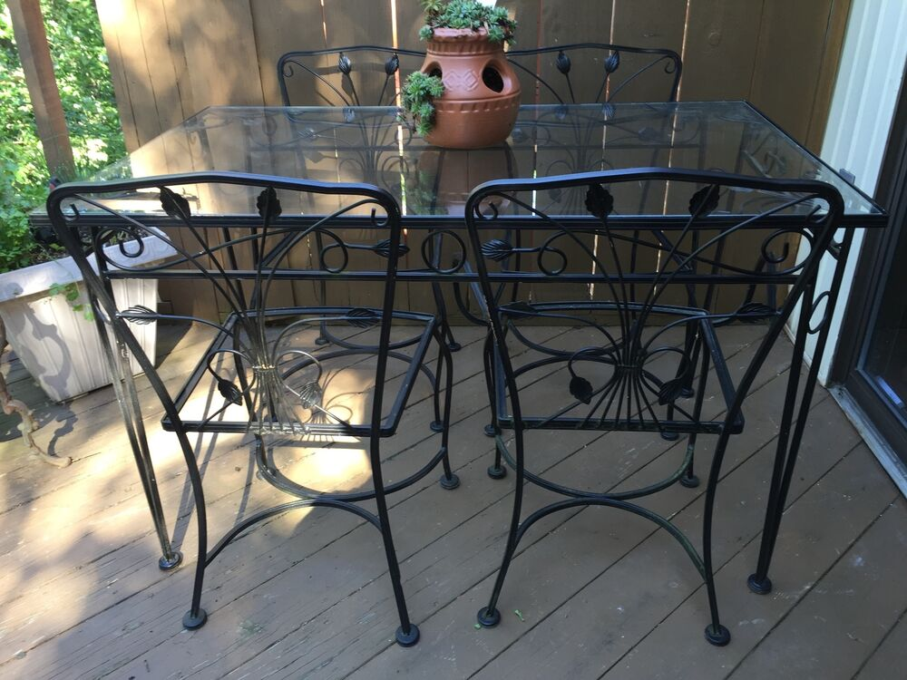 Vintage salterini wrought iron patio table and four chairs for Metal patio table and 4 chairs