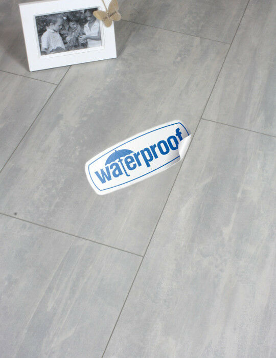 Waterproof click tile effect laminate flooring light grey for Grey bathroom laminate flooring