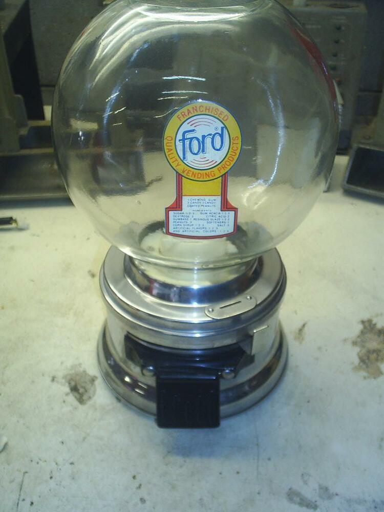 Old nice ford gumball machine with free ford gumballs 1965 for 99 cent store motor oil