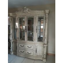 Large antique white china hutch. Four glass doors, two drawers, two cabinets.