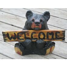 Chainsaw carved black welcome bear