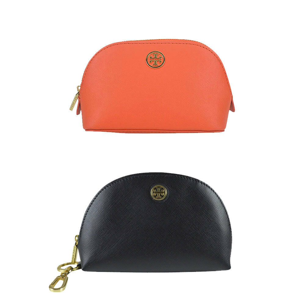 ee385cab8e78 A zippered Tory Burch mini dome pouch crafted in metallic saffiano leather.  Gold-tone key ring and logo stud.