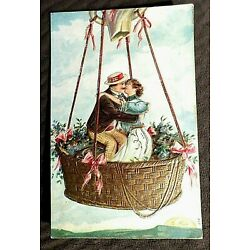 Kyпить KISSING COUPLE IN HOT AIR BALLOON W/  SETTING SUN, HEAVILY EMBOSSED,GOLD ACCENTS на еВаy.соm