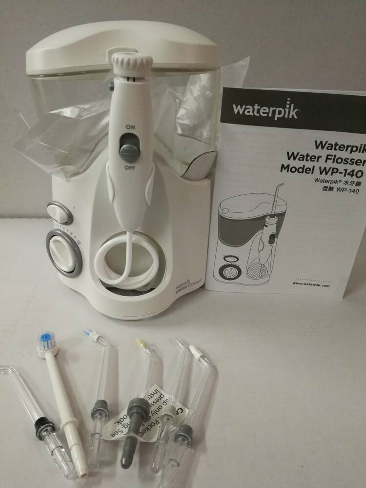110v waterpik wp 140 flosser with 6 tips without packing ebay. Black Bedroom Furniture Sets. Home Design Ideas