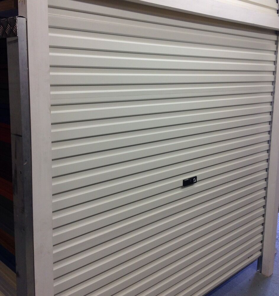 Roller garage door in white sealed manual fully installed installation