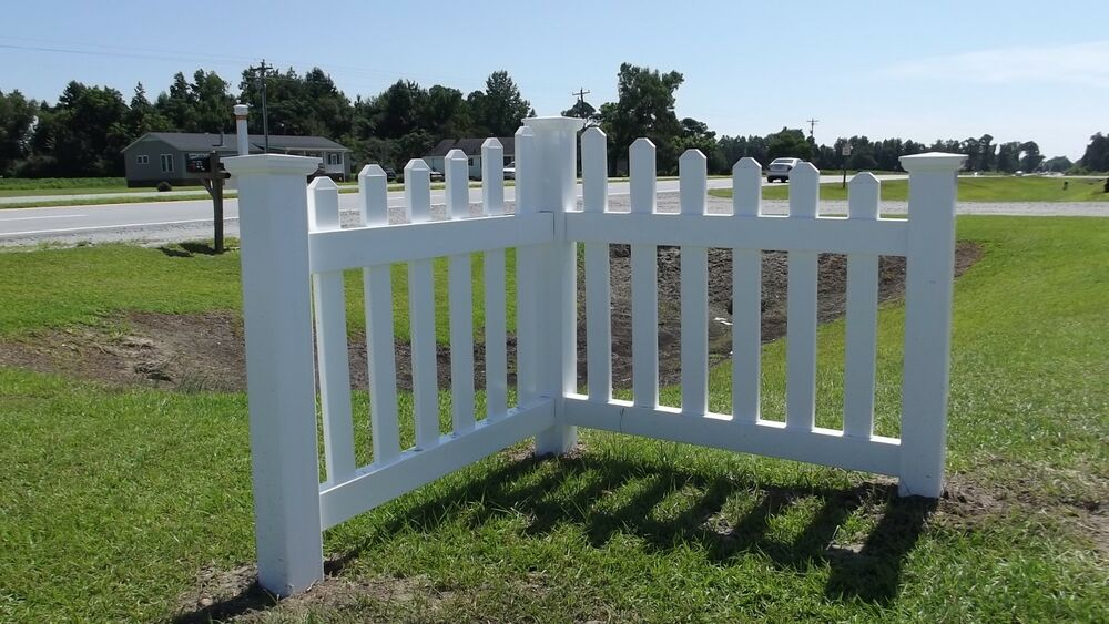 Angled corner picket fence driveway garden accent white