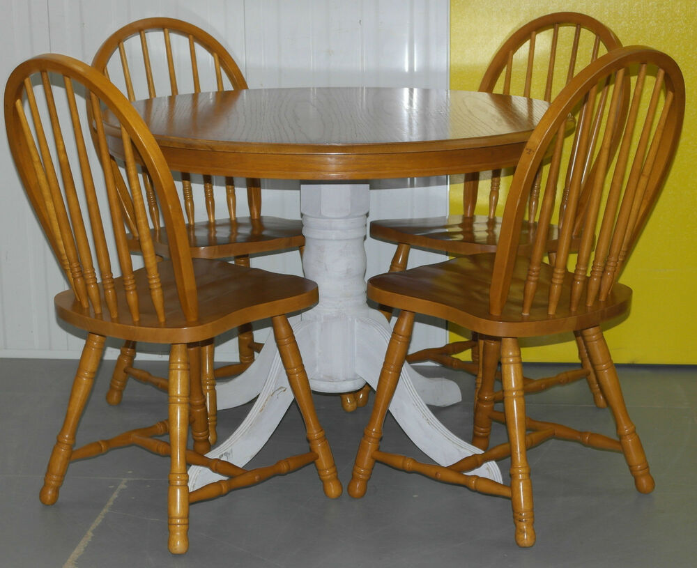 solid pine round dining table and four windsor backed dining chairs