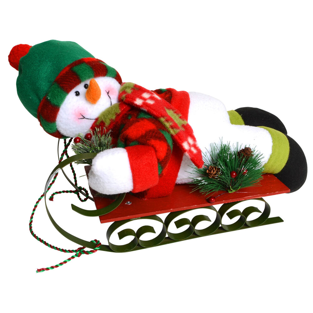 Cute plush snowman on painted metal wood sledge
