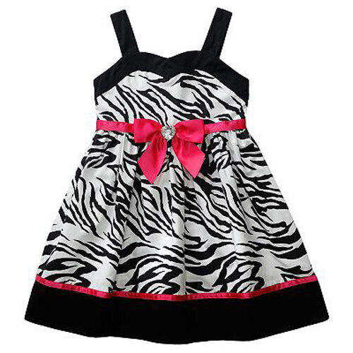 MudPie baby dress from the Wild Child line. Black bust and sleeves with zebra print ruffles on the dress. Bright blue rickrack adorns the chest and separates the zebra dress from the black.