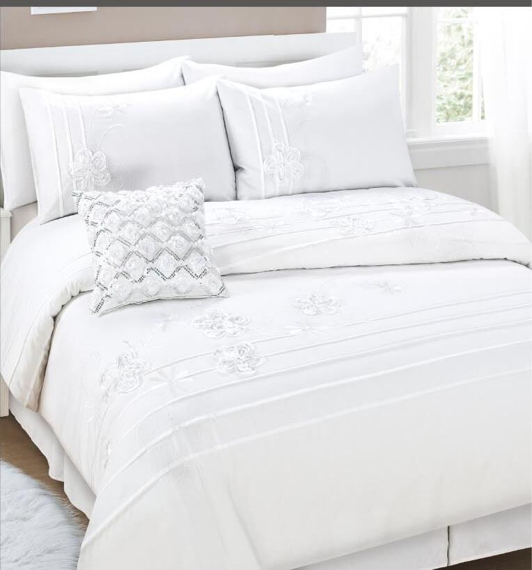 A duvet cover set typically includes a duvet cover and a pair of pillow shams, which are decorative cases for pillows. A quilt is a padded bed covering made of several pieces of fabric stitched together in a decorative design.