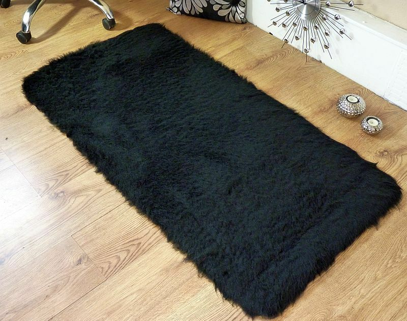 black faux fur rug black faux fur sheepskin style oblong rug 70 x 140cm 4669