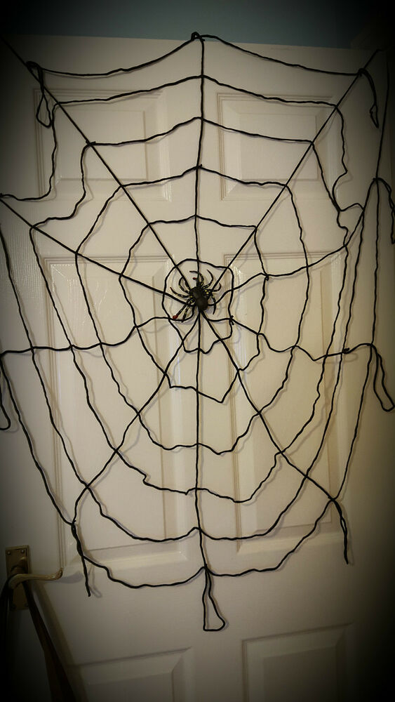 halloween indoor outdoor giant nylon black spiders web. Black Bedroom Furniture Sets. Home Design Ideas