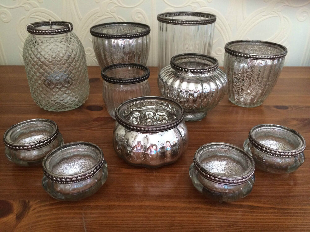 A Selection Of Glass Tea Light Holders Clear Or Silvered