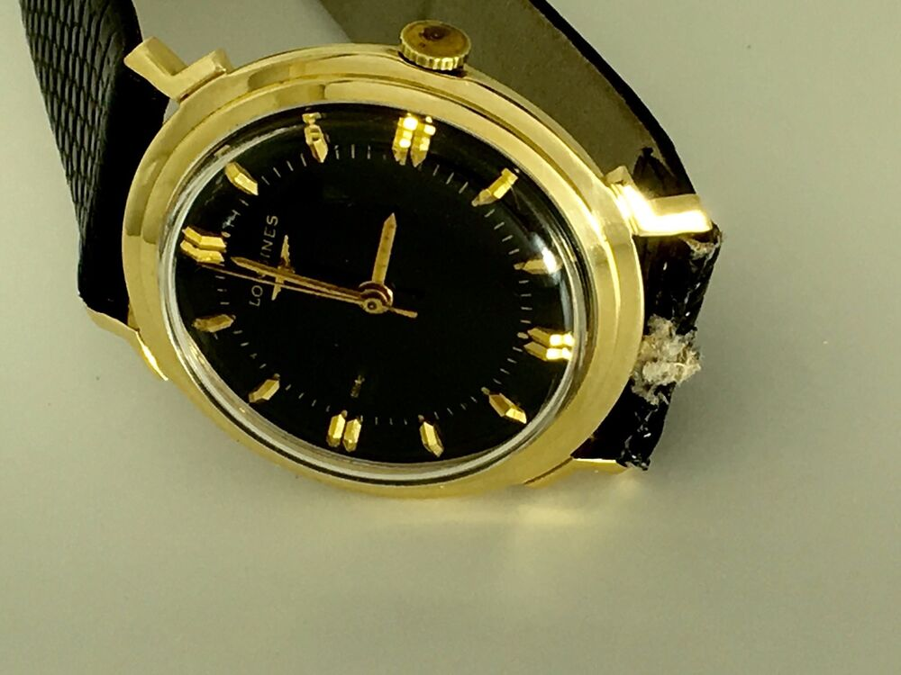 14k solid gold longines with black