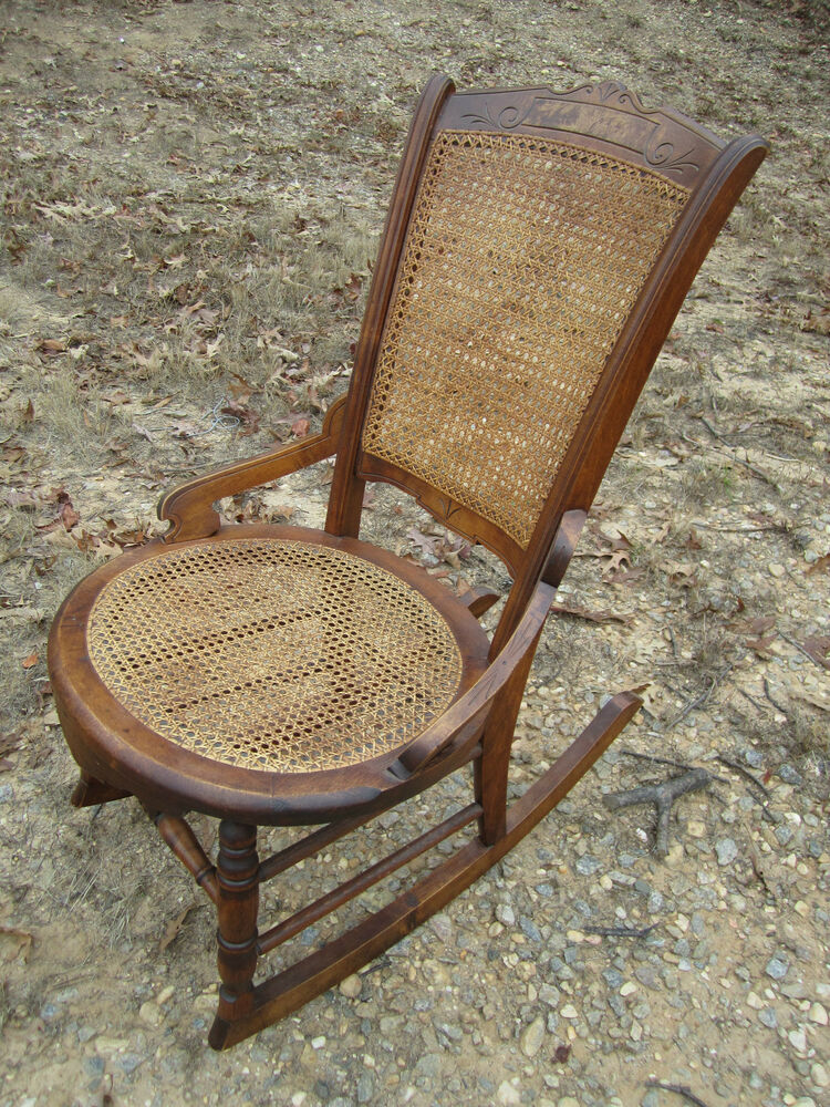 Antique american th century walnut rocking chair caned