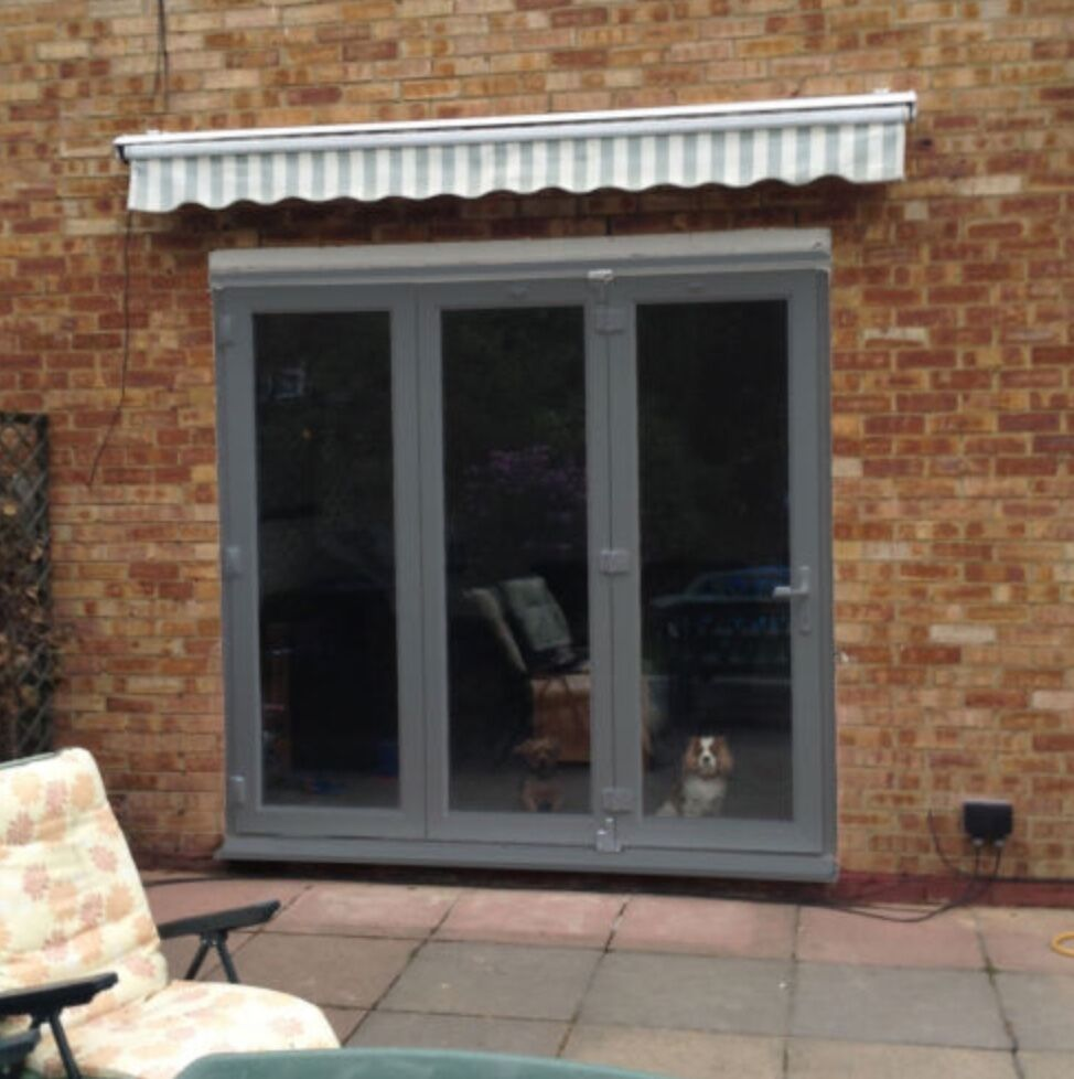 Upvc bifolding patio doors white oak grey rosewood for Upvc french doors grey