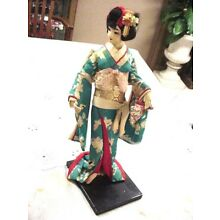 2 CLOTH GEISHA DOLLS WITH SILK KIMONOS ON WOODEN STAND, ONE BLUE ONE PALE YELLOW