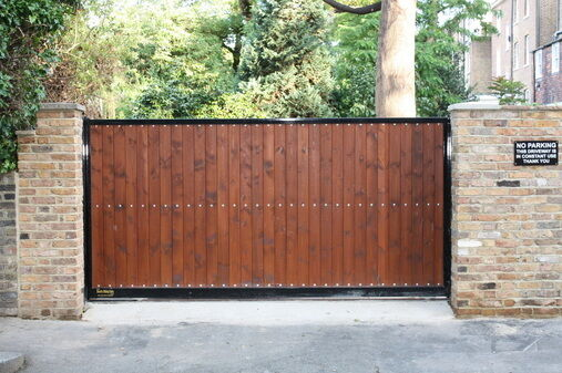 Electric sliding driveway gate 39 olivia 39 steel and wood for Wooden sliding driveway gates