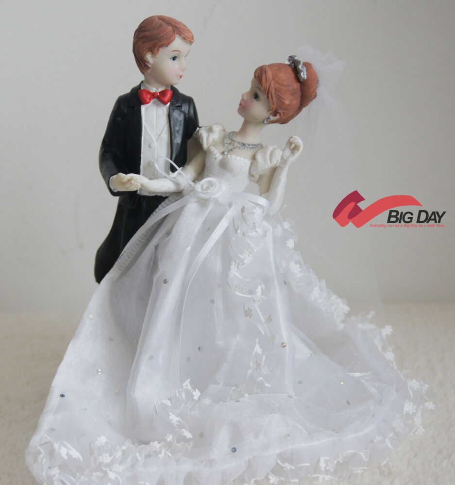 wedding cake bride and groom figurines together and groom wedding cake topper 22087