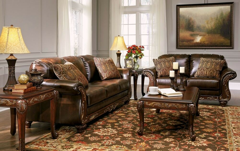 Vanceton mocha brown leather traditional wood sofa for Traditional living room sets