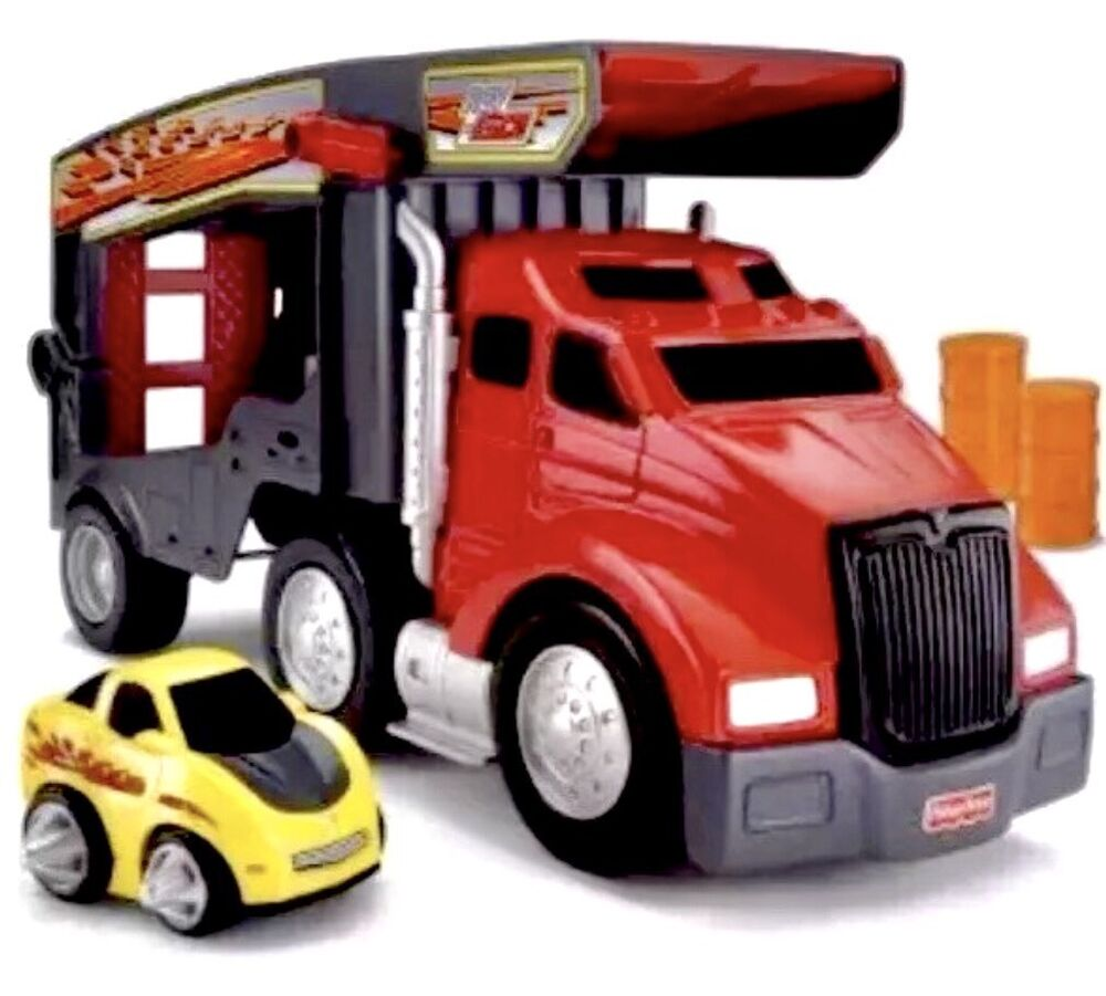 fisher price stunt hauler truck stunt car rev n go play. Black Bedroom Furniture Sets. Home Design Ideas