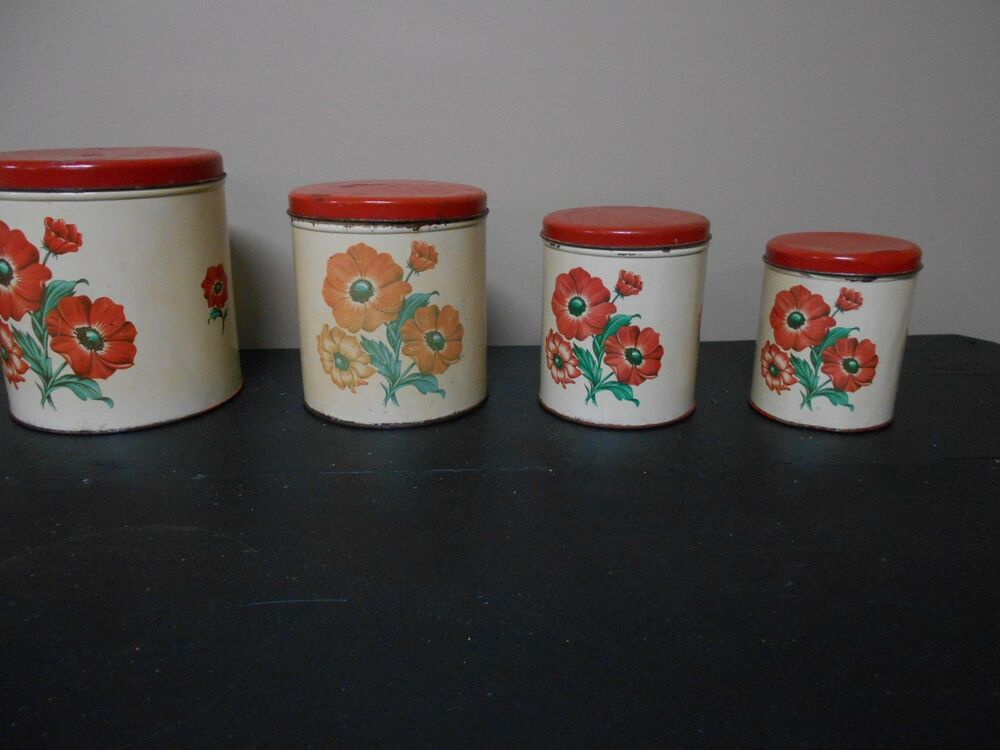 4 PC. SET OF VINTAGE MID-CENTURY RED FLORAL METAL CANISTER