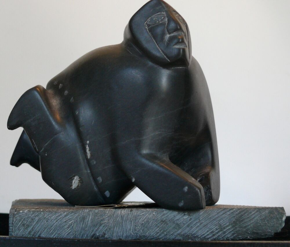 Native american inuit carving the hunter sculpture canada