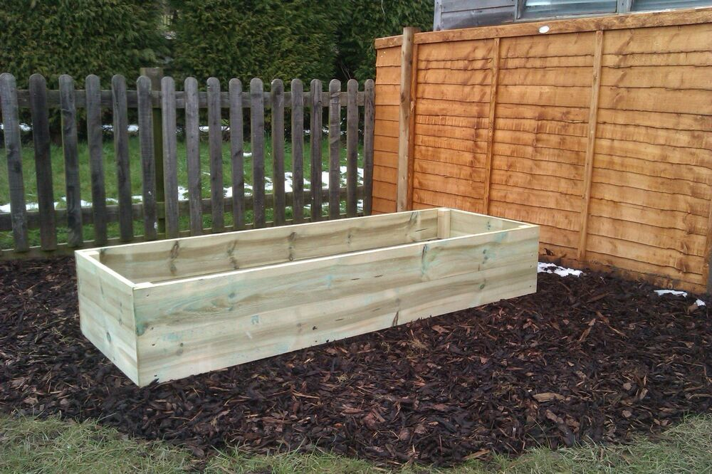Hand made wooden garden raised bed planter border for Raised border edging
