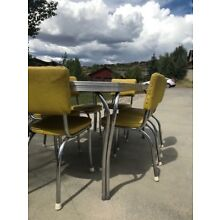 Vintage 1950's formica table and chairs great condition.